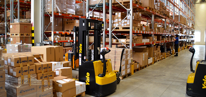 Inside of a warehouse with a forklift