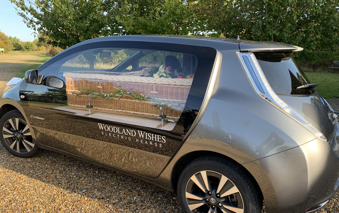 Electric Hearse Gives Natural Burial And Cremation Specialists Woodland Wishes An All-Round Environmentally Friendly Funeral Service.